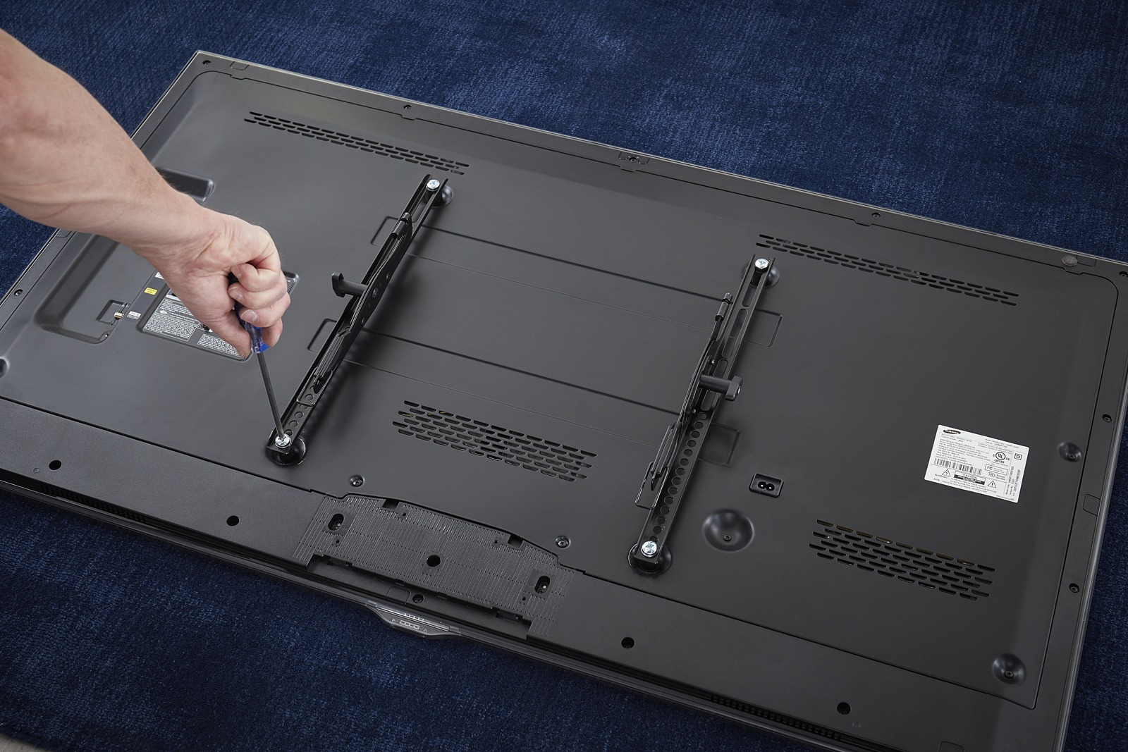 Mounting a TV - Attach Brackets to Back of TV